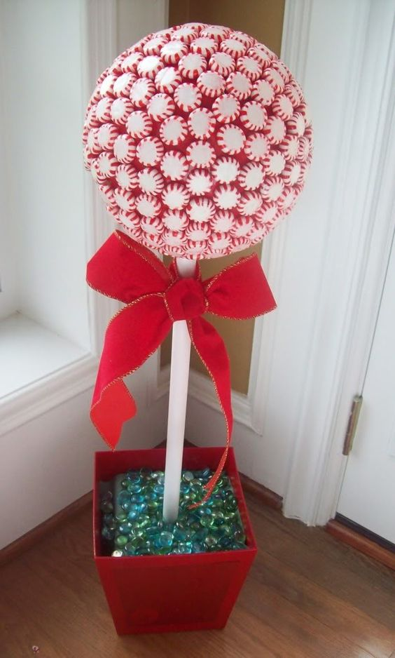 Handmade peppermint candy topiaries for Christmas decoration.