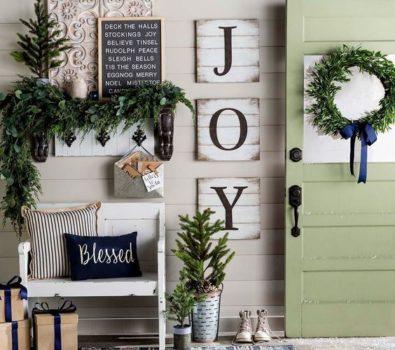 Impressive holly jolly Christmas entry way decoration.