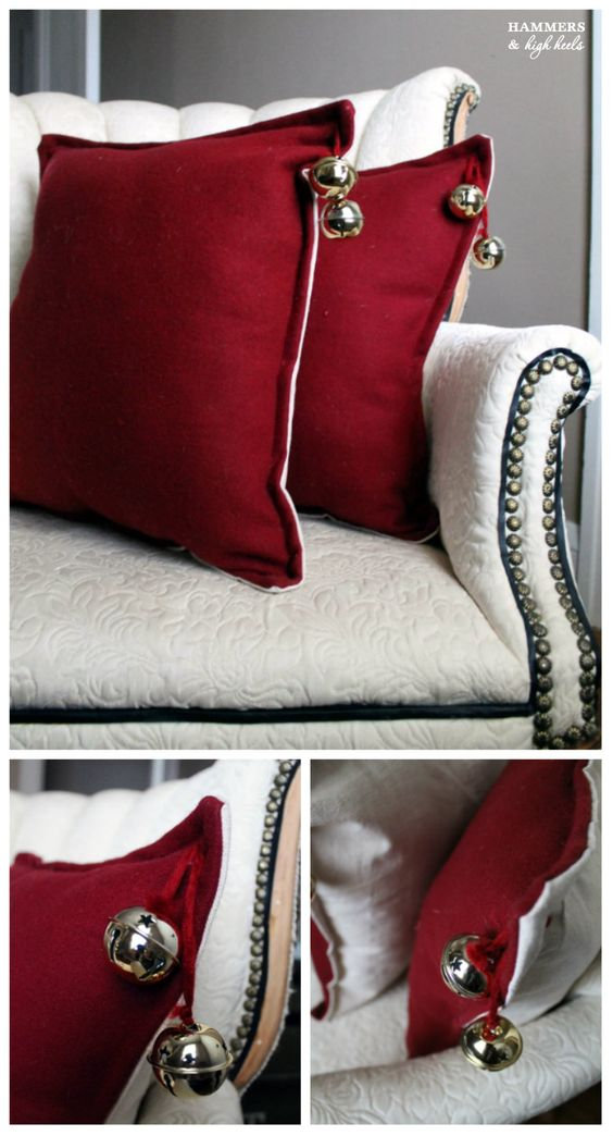Jingle bells hanging on red pillow covers.