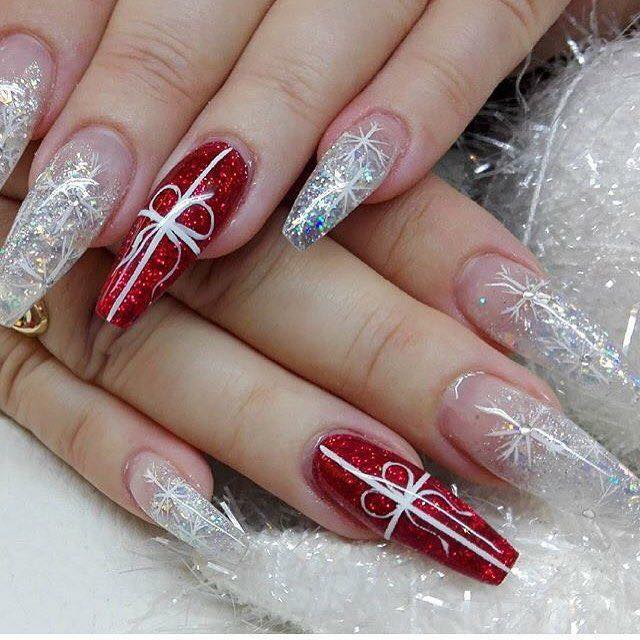 Long red and white glitter nails.