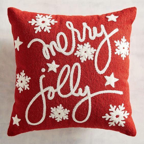 Merry and jolly pillow cover with snowflakes and stars.