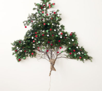 Mini wall tree with red star tree topper.