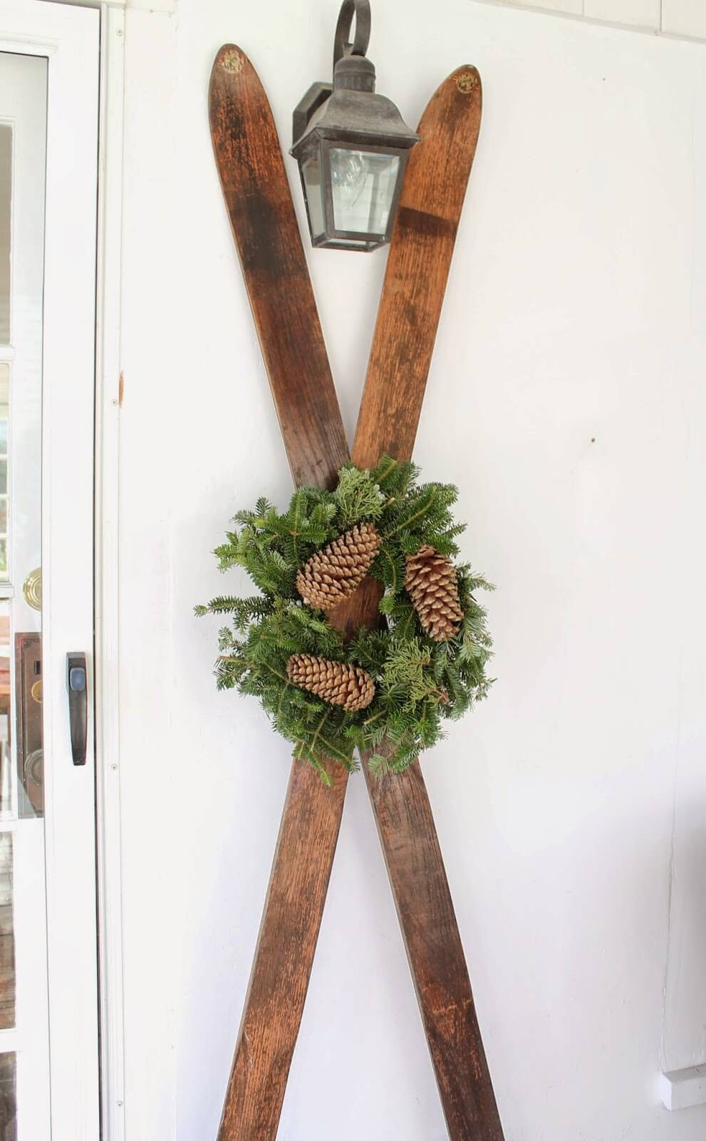 Nice antique skis with pinecone wreath.
