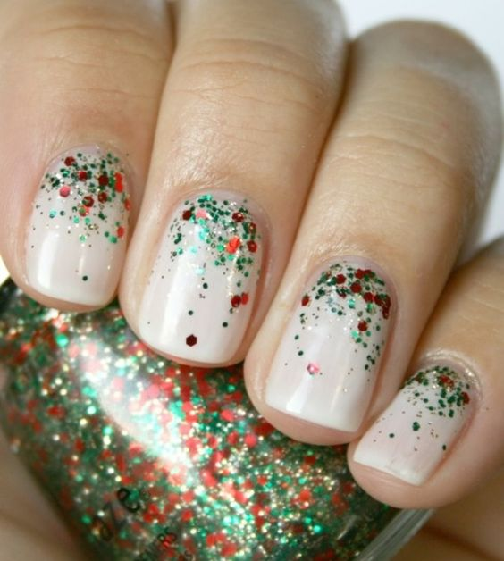 Nude nails with red and green glitter.