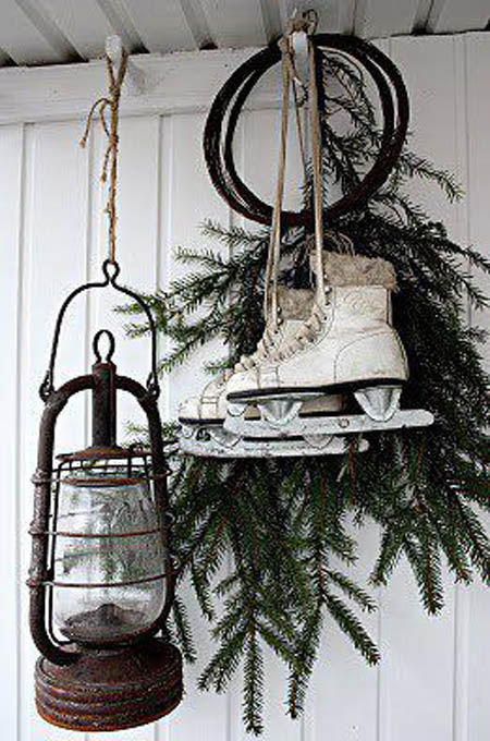 Pair of skates and lantern hanging together fot outdoor Christmas decoration.