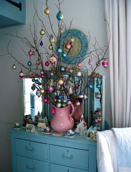 Pink vase with colored ornament on tree.