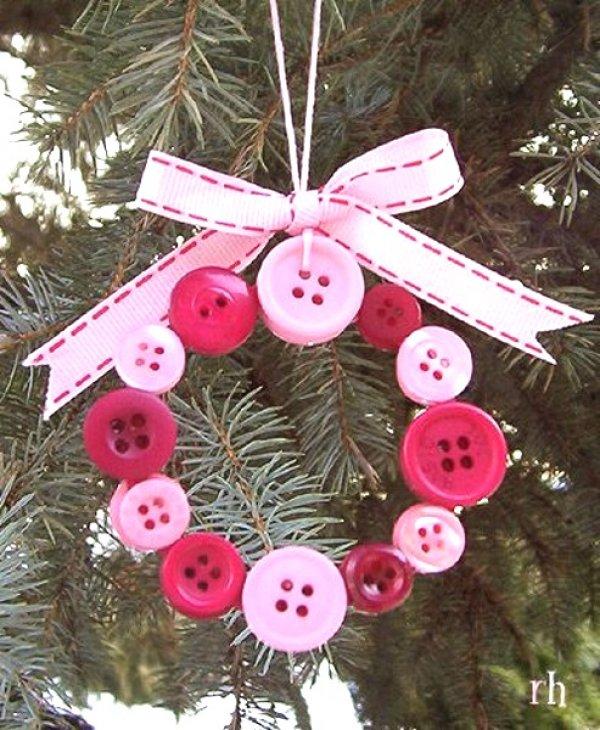 Pretty pink button wreath wit green ribbon.