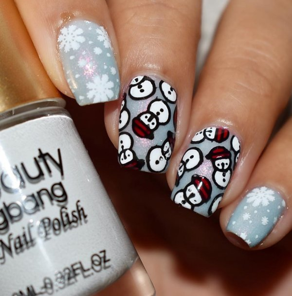 Pretty snowman on grey nails with snowflakes.
