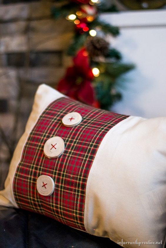 Pretty tartan plaid pillow with wooden buttons.