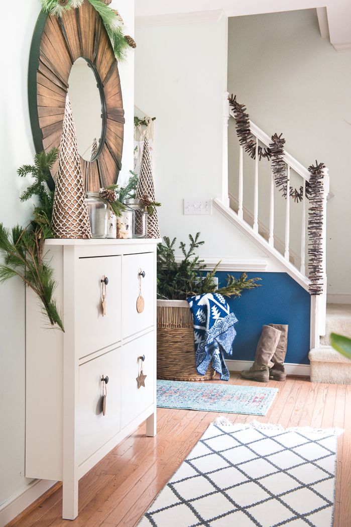 Pretty wood garland oon stairrs on natural element.