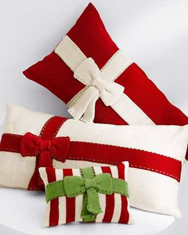 Red and white pillow with green bow.
