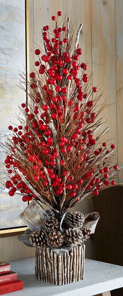 Rustic Christmas centerpiece with pinecones and berries.