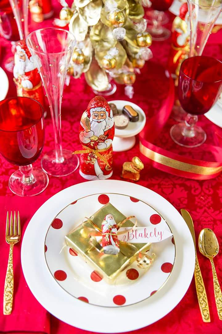 Santa is waiting for your guests at Christmas table.