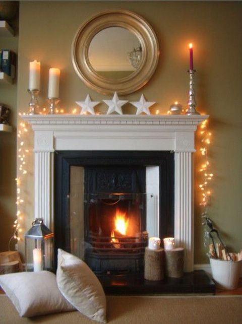 Simple mantel decor with candles, stars and lights.
