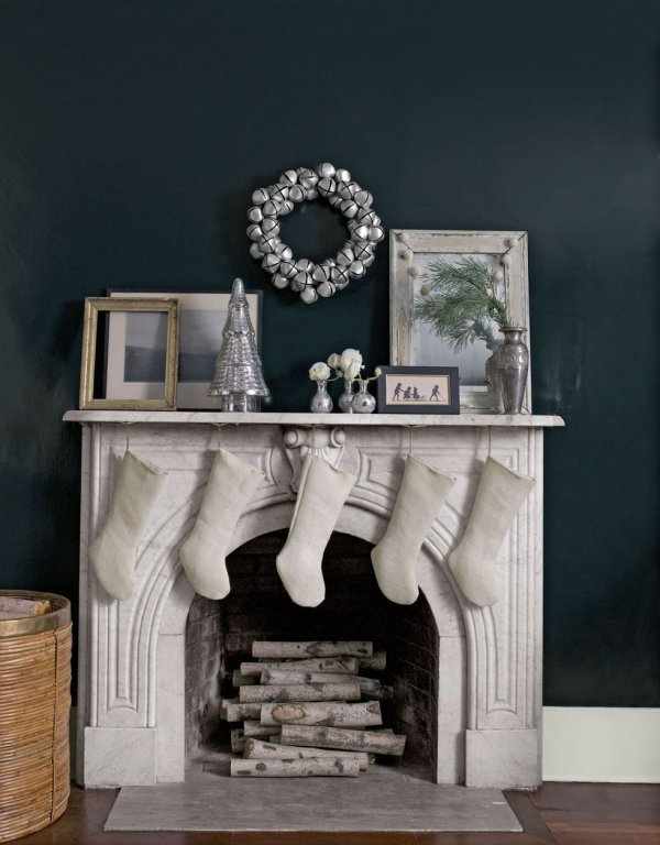 Sophisticated grey and white Christmas mantel decor with beautiful jingle bell wreath.