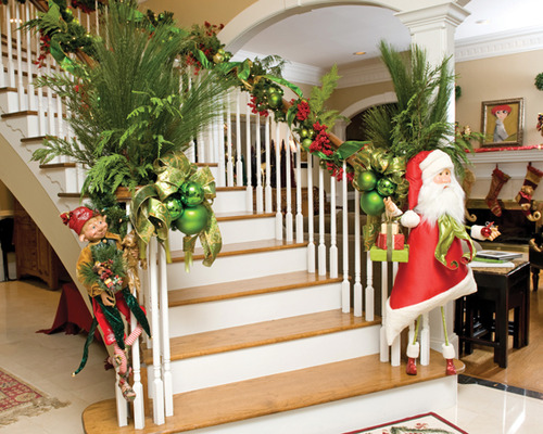 Stunning Christmas stairs decoration with Santa welcoming your guest with open arms.