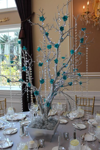 Swanky centerpiece of silver tree with tiffany flowers and crystals.