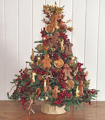 Table top Christmas tree with gingerbread ornaments.