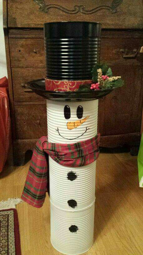 Tin boxes arranged as snowman for indoor decoration.