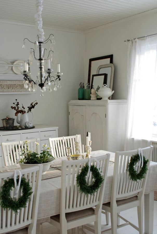 Tiny wreath on chairs look fabulous in shabby chic theme dinning area.