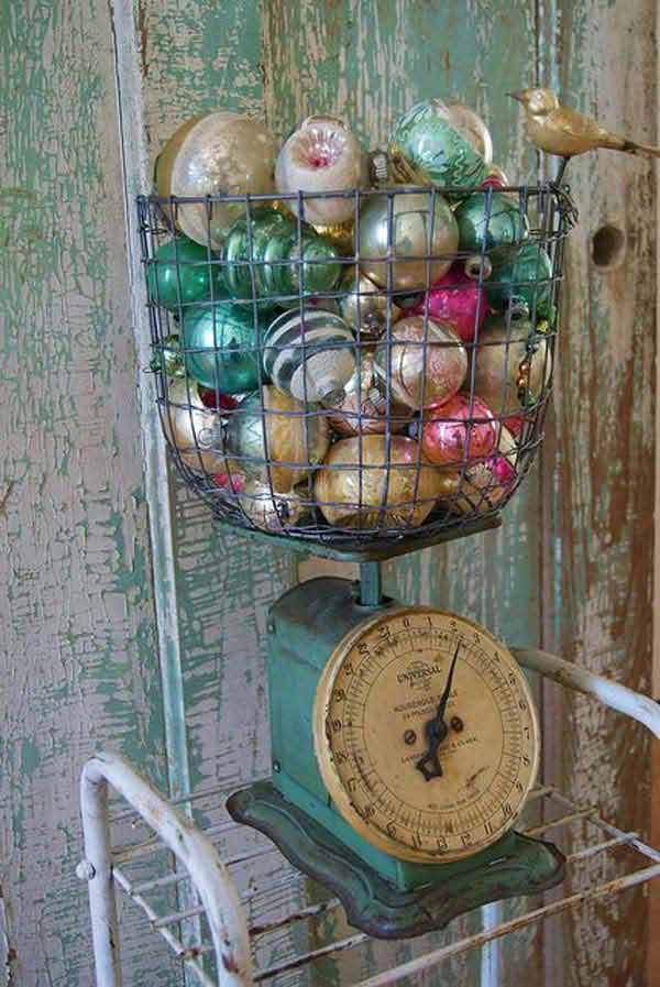 Weighing machine filled with colorful ornaments used for vintage Christmas decoration.