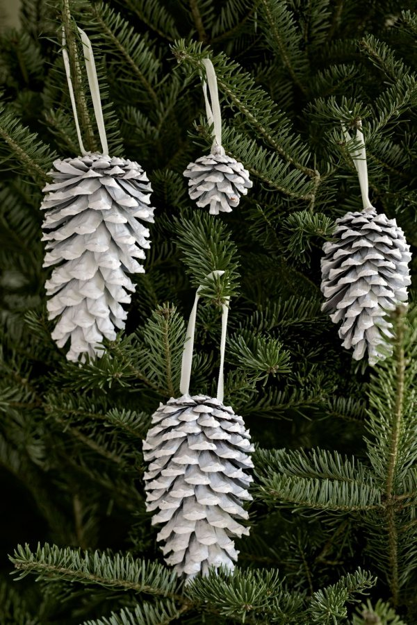 White spray painted pincone ornaments.