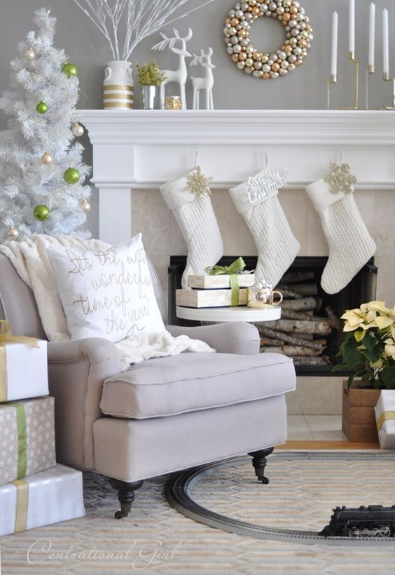 White theme mantel decoration with golden ornament wreath.