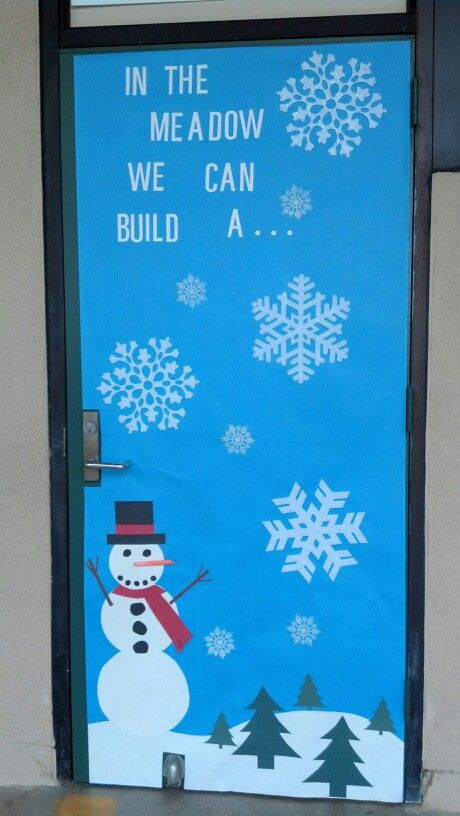 Winter classroom door decor with snowman and snowflakes.