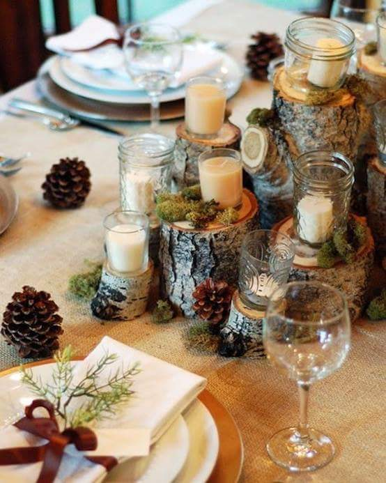 Wooden candle holder decoration with beautiful cutlery.