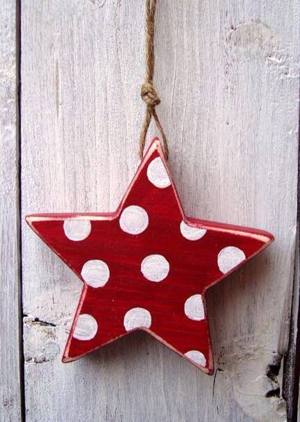Wooden star painted in red and white polka dots star ornaments.
