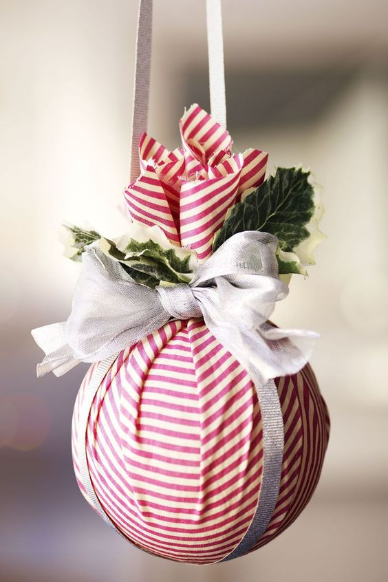 Wrap a ball in red & white cloth and tie nicely to make ornaments.