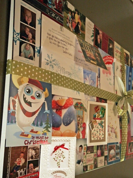 Old Christmas cards used to decorate wall.