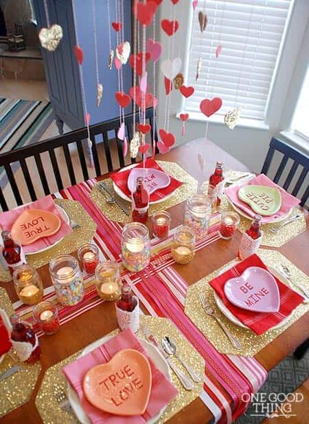 Add some hanging hearts with mason jar candles and heart shape cutlery.