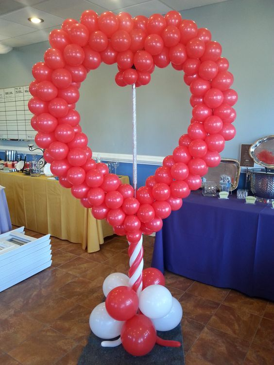 Adorable heart shape balloon photo booth for party.