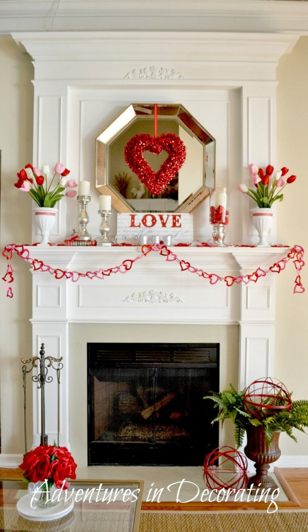 Amazing mantel decoration with heart wreath.