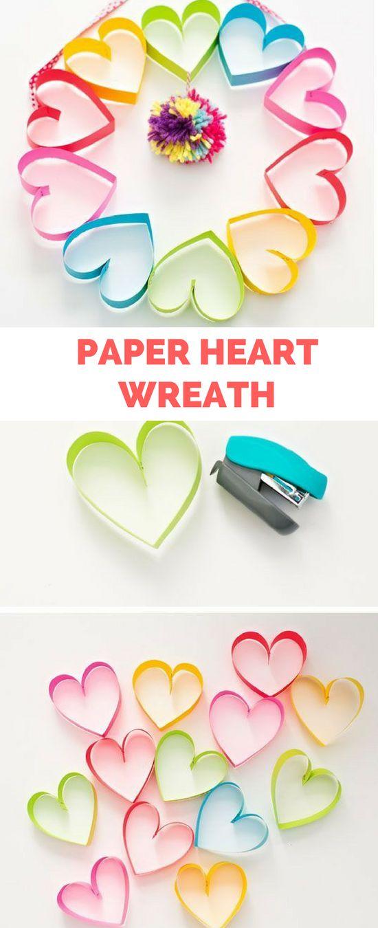 Awesome diy rainbow paper heart pom pom wreath.