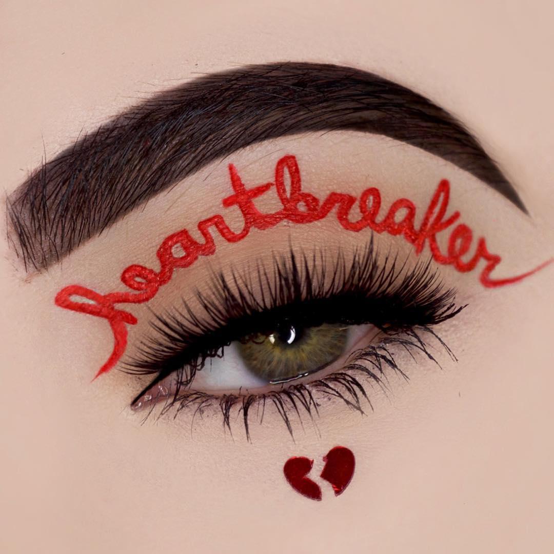 Awesome heartbreaker eye makeup.