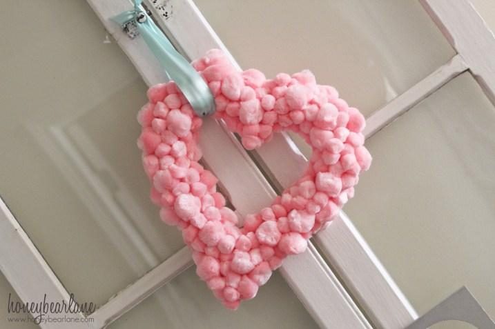 Awesome pink pom pom heart shae wreath.