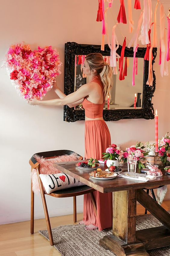 Beautiful floral heart and table decor for Valentine party.