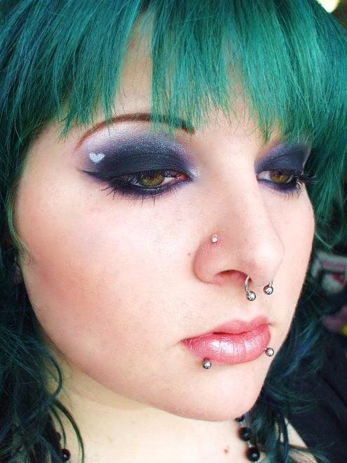 Black eye shadow makeup with heart.