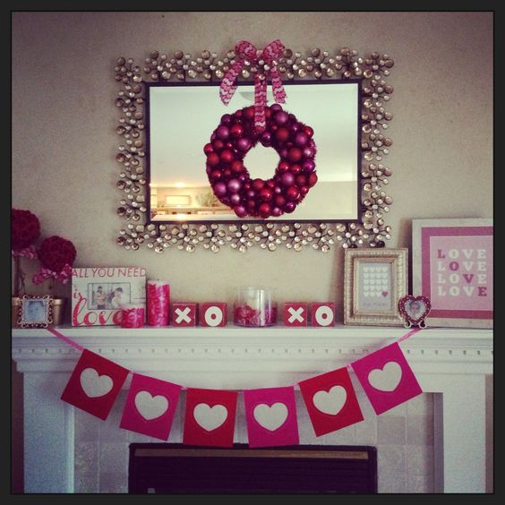 Bright pink mantel decor for Valentine's day.