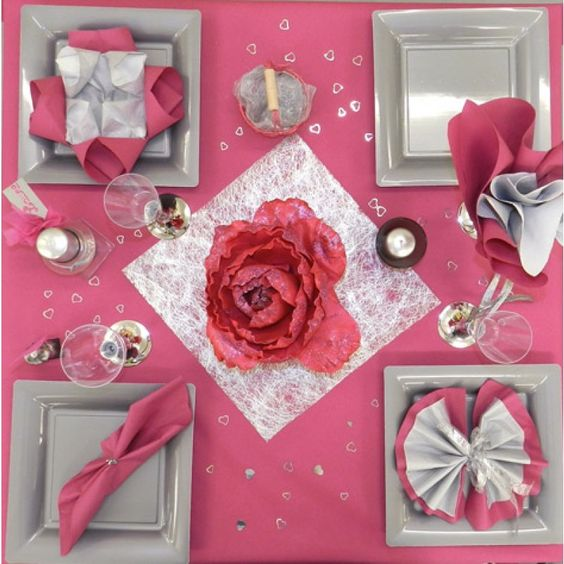 Catchy pink table setting for romantic day.