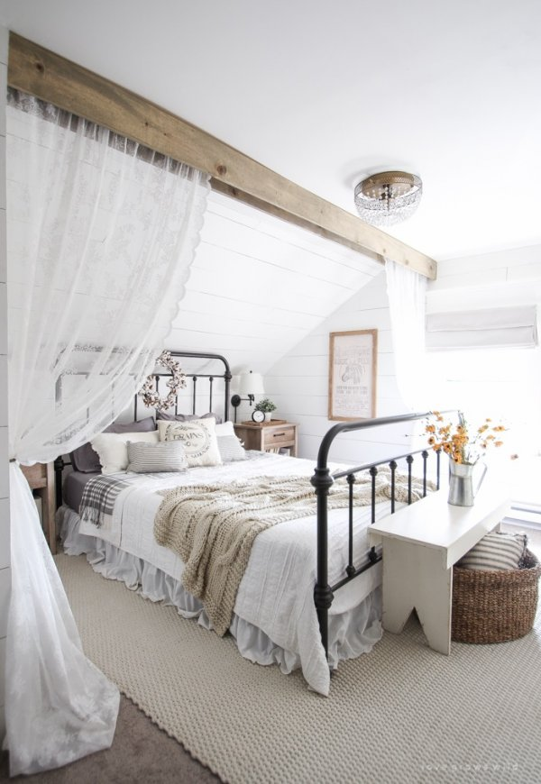 Charismatic bedroom decor with floral wreath.