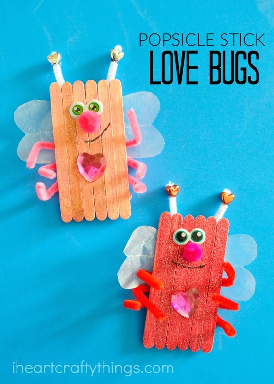 Charismatic popsicle stick love bugs for Valentines day craft.
