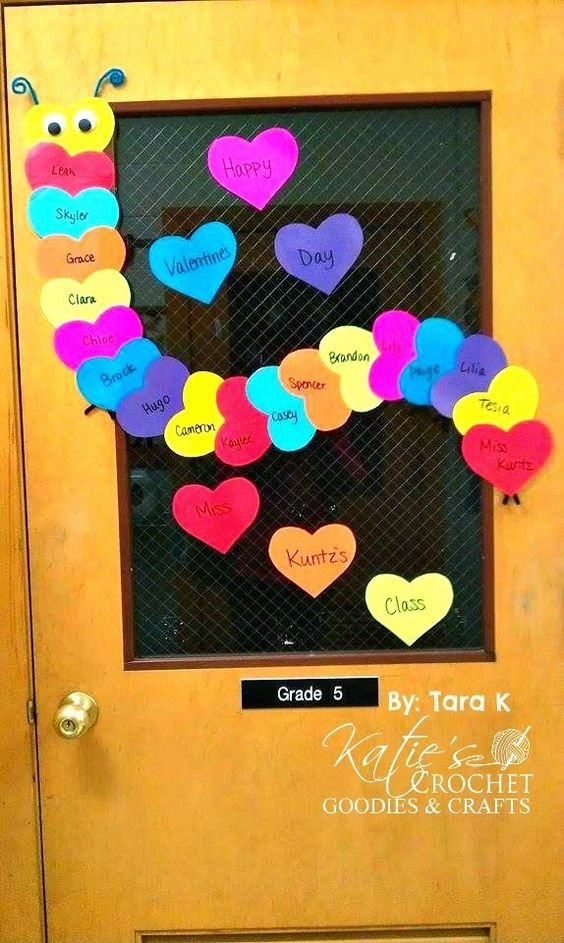 Colorful heart caterpillar classroom door decoration.