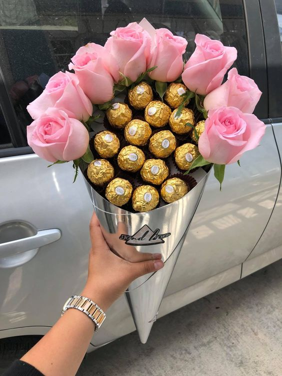 Combo of chocolates and flowers bouquet.