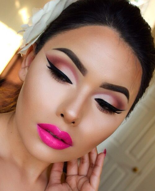 Cool orchid lips with warm eyes for party look.