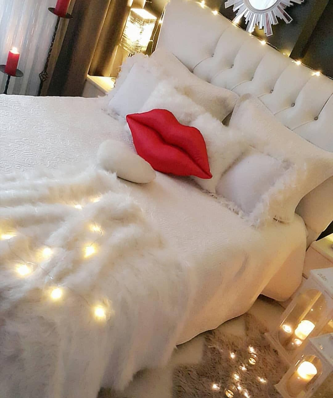Cool romantic bedroom decor with lips pillow.