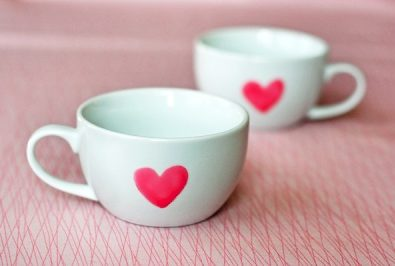 Cups are painted with hearts.
