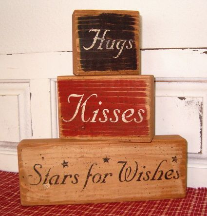 Cute hugs and kisses rustic sign boards.